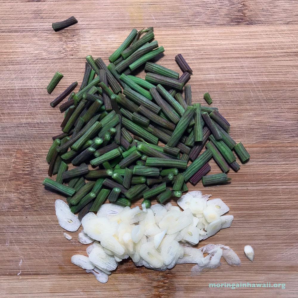 Young Moringa seeds pods with garlic