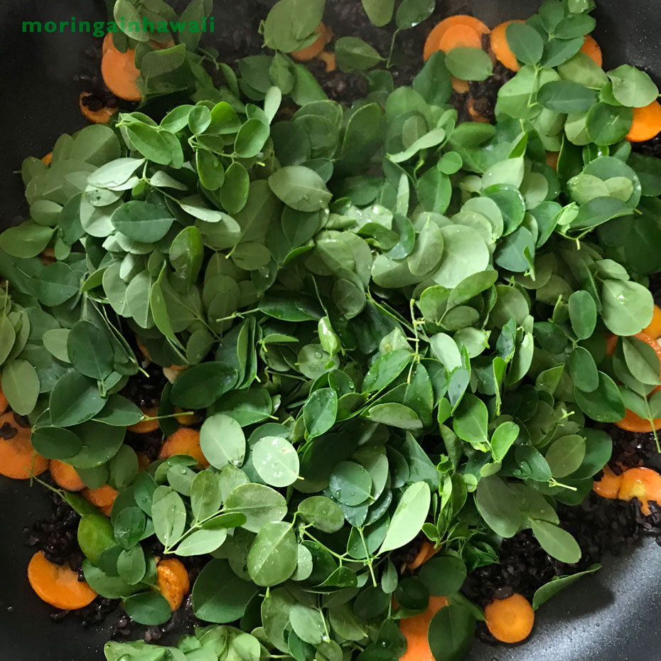 Fresh moringa leaves with organic forbidden rice